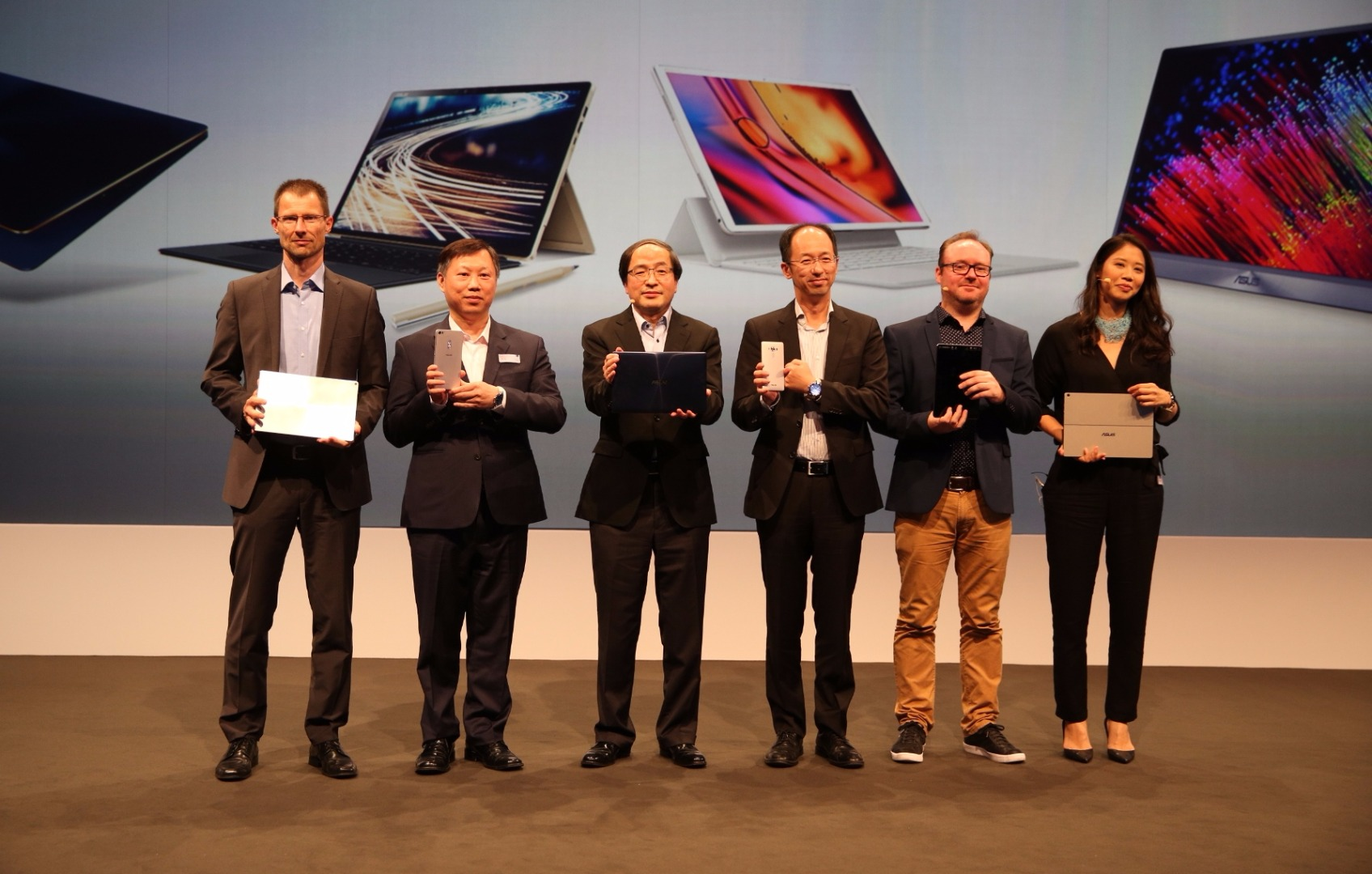 ASUS Vice President Eric Chen is joined on stage with ASUS VIPs for the Zenvolution-